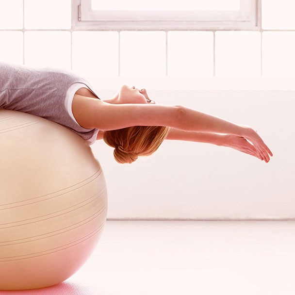 woman on a medicine ball training