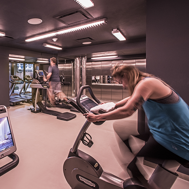 Image of people on fitness equipment at Virgin Hotels